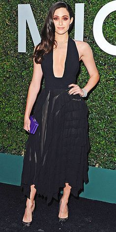 EMMY ROSSUM For the launch of Claiborne Swanson Frank's Young Hollywood in Beverly Hills hosted by Michael Kors, Emmy picks a plunging chiffon dress by the designer and adds a pop of color with a purple MICHAEL Michael Kors clutch.