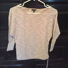 Express semi sheer shirt size XS Gray semi sheer shirt with ruching on one side.  Size XS from Express. Used but in great condition. No holes or stains.  Very cute. Price is negotiable. Save even more by bundling!! Express Tops
