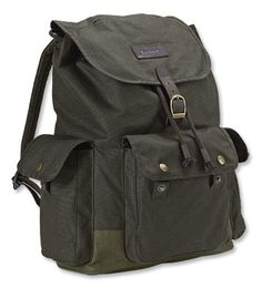 A smart design and sturdy waxed cotton protect your things in this large backpack by Barbour.