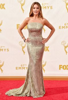 Sofia Vergara wears a metallic St. John strapless dress