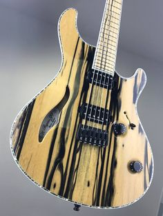 """Mayones Regius Semi-Hollow 6 Master Builder Collection, Ebony Pale Moon top, Trans Natural Gloss finish, Black Korina body wings, 11-ply 'Exotic I' neck-thru-body section, Ebony Pale Moon fingerboard, 16"""" fingerboard radius, 25.4"""" scale, 24 Ferd Wagner jumbo frets, only side dot markers, 3-ply White ABS / Gray Acrylic Pearl binding, Seymour Duncan TB-4 JB & SH-2 Jazz humbucker set, Electroswitch Electronic Products 3-way slide pickup selector, Volume (push-pull for coil splitting)"""