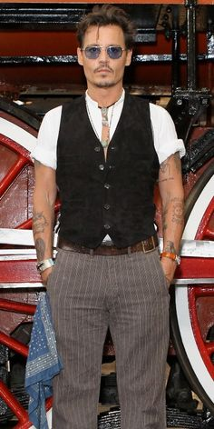 Johnny Depp I dare say it but this man started my infatuation with men with tattoos