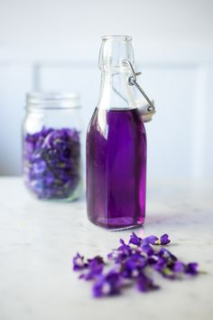 An old-fashioned recipe for Violet Simple Syrup, (using cups vs.grams) perfect for cocktails like a violet infused French 75, the perfect Wedding Cocktail.