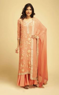 Go gorgeous in this elegant coral gables embroidered georgette kurta with coral gables crepe farshi pants. The jaal embroidery in aari, pita, gold, zari, sequins and resham and the plain coral gables georgette dupatta will command attention. Ideal for a friend's or family wedding.