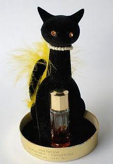 Vintage black velvet Cat perfume holder. OMG I had this! Perfume smelled terrible but I didn't care.