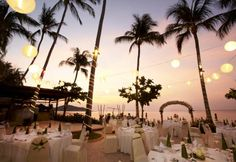 Stunning perspective of the terrace at sunset. Chinese lantern decoration add a magical touch. Beach Weddings Thailand