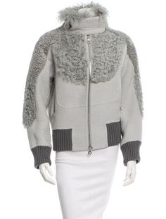 Grey Marc Jacobs puffed doubleface bomber jacket with mixed fur trim accent panels throughout, dual welt zip packets at front, rib knit trim throughout and silver-tone exposed zip closure at center front.