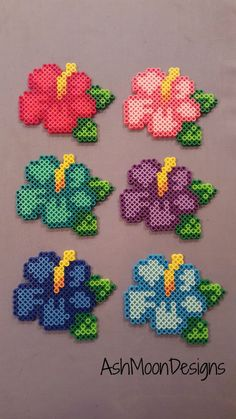 Perler Bead hama Hibiscus Flowers by AshMoonDesigns on Etsy Easy Perler Bead Patterns, Melty Bead Patterns, Perler Bead Templates, Diy Perler Beads, Perler Bead Art, Beading Patterns, Pearler Beads, Diy Perler Bead Crafts, Mini Hama Beads