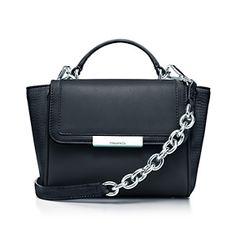 Quinn top handle bag in smooth leather, small. More colors available.