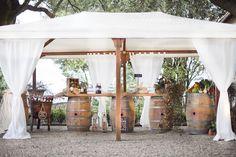Wedding at castello vicchiomaggio, country style buffet, wine barrels, buffet in the garden, greve in chianti,