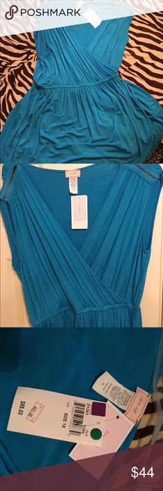 Super cute faux wrap mini dress with zipper This super cute turquoise midi dress has a surplus top and faux wrap with elastic waist band and nice full swing bottom with a tulip edge. Accented with zippers on the shoulder. Brand-new with tags. Too cute to pass up. Dresses Midi
