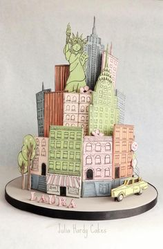 This cake was based on a wonderful print by Anna Bond (in other pics) which I came across whilst searching for inspiration on Google. As soon as I saw it I knew it had to become a cake! :-) I added the Statue of Liberty because she is special to...
