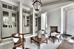 Love all the french doors. Colors. Chairs. Decor. Patio. Dying over this!
