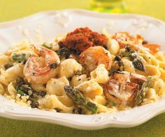 Orecchiette pasta with tiger prawns and asparagus served with Brie cream and topped with sun-dried tomato pesto and deep-fried capers. Photo by Chris Cassidy. Recipe by Executive Chef Jeffrey Madura of John Ash & Co. Restaurant in Santa Rosa, CA.