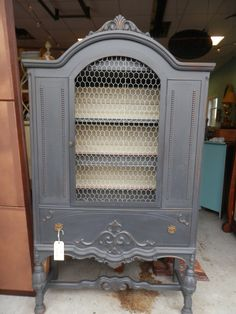 "I used Annie Sloan ""Graphite"" paint and used a coat of wax. I used chicken wire for the hutch door."