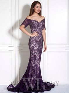 Isidora Dress. An elegant full length gown by Jadore. An off shoulder style…