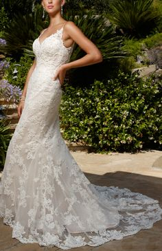 Casablanca Bridal Wedding Dress-  If I (when I )get remarried, I would like a dress like this.  Pretty, classy, and elegant without going too far.  Its still simple.  Love It!