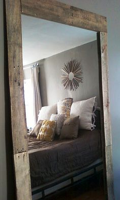 DIY mirror with natural wood frame.