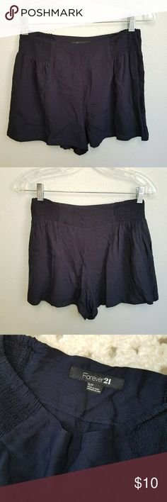 """Forever 21 High Waist Loose Fit Shorts Forever 21 high waist elastic rouched side waist shorts. Pockets at side. 100% rayon. Super soft material. Navy color. Looser fit. Size Small. 13.5"""" waist, 2 14/"""" inseam, 12 1/4"""" rise, 22"""" hips. Forever 21 Shorts"""