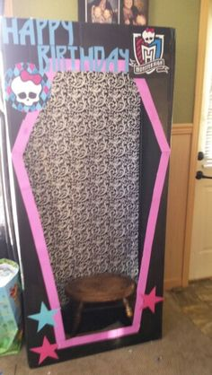 Refrigerator box into Monster High doll box for party photo booth. Used wrapping paper for the inside back and printed off Monster High images with my cut out letters glued on upper front.