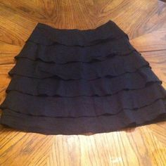 Ann Taylor black ruffle skirt Adorable 0 petite black ruffle skirt. Worn only twice. Great condition, just needs to be ironed a bit. Ann Taylor Skirts