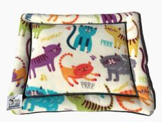 Very colorful and fun playful cats and kittens cat is the theme for this cat pad and is soft and padded to them to rest on. Its easy to wash and dry and can be placed anywhere your pet wants to be and theyre a perfect crate liner. With so many uses for pet pads, theyre perfect for the to put on your furniture to protection. Dogs and cats just want a place to go to, a place that is theirs. My pads are perfect for about anywhere you pet wants to be; on the couch, laying in front of the door…