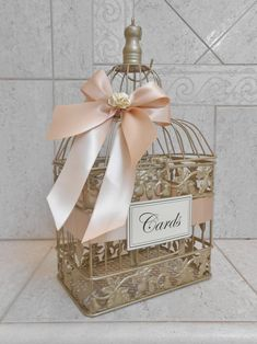 ♡ You choose your colors! ♡ Shown painted Champagne Gold, with blush satin ribbon, ivory paper flowers, and ivory cards sign. Cage measures approximately 15 x x It will hold approximately cards. For other sizes please check below, or send me a message. Trendy Wedding, Gold Wedding, Diy Wedding, Wedding Ideas, Wedding Planning, Wedding Tables, Wedding Flowers, Wedding Inspiration, Wedding Dresses