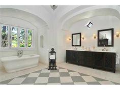 The bathroom in this exquisite 1929 DeGarmo has been lovingly restored to its original splendor.