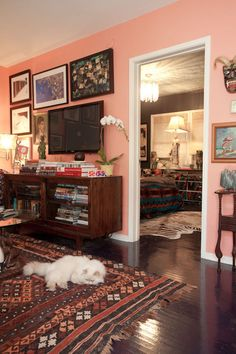 omg I love everything about this. Everything from the paint color, the textiles, to the cat!