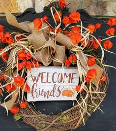 This GORGEOUS Welcome Friends Fall front door wreath is the perfect simple accent for your door or interior. T