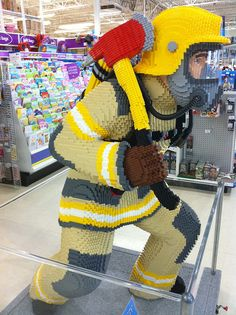 Lifesize LEGO firefighter... I wonder if I could commission the hubs to figure this one out for a certain little boy's birthday...  Probably  not