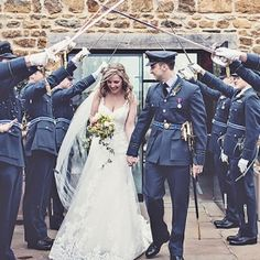 An elegant and chic wedding in the English countryside with a bridal party in RAF uniforms and decadent pink. A must see!