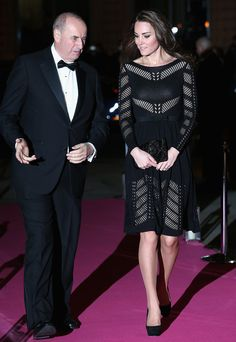Catherine, Duchess of Cambridge, aka Kate Middleton, attends the Action on Addiction Autumn Gala at restaurant L'Anima in London's East End. Kate is wearing Temperley London's Emblem Flare dress, Jimmy Choo Cosmic heels, a new unidentified handbag, and her deco-style diamond drop earrings. 10/23/14