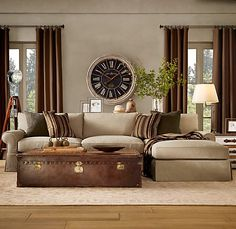 Love the clock and the couch...shelf and accent deco.