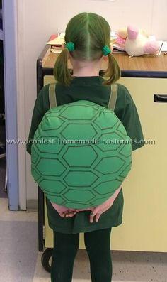 http://www.coolest-homemade-costumes.com/tortoise-costume-2.html    cardboard, green felt, stuffing, spray fabric adhesive, ribbon shoulder straps, permanent marker