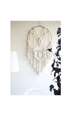 Macrame dreamcatcher with thick natural cotton rope. Ethnic
