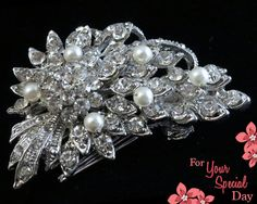 This hair brooch comb looks just like a miniature bouquet of flowers! Made of grade A+ crystal rhinestones, fresh water ivory pearls and antiqued silver plated metal. Such a great accent to an amazing hairstyle on Your Special Day. by ForYourSpecialDay, $34.99