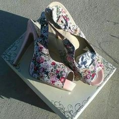 Floral print and patent BRAND NEW platforms These are super cute. They are brand new in the box. Grommet detail along the platform. Floral fabric upper. Pink patent wrapped heel. Sling back with buckle design. Charles albert Shoes