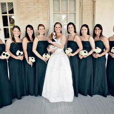 Though she opted to have her bridesmaids dress in black to match the groomsmen, the flowers (and, of course, Meridith's gown) tied in the wedding's color scheme.
