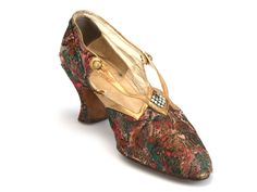 Shoe-Icons / Shoes / Dark red, brown and green brocade pumps with gold leather strap connected with the tongue.
