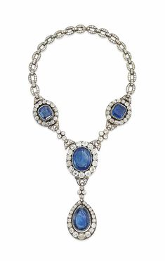 AN ANTIQUE SAPPHIRE AND DIAMOND NECKLACE -  Composed of three sapphire and diamond clusters joined by diamond collet quatrefoil accents, suspending a further sapphire and diamond drop pendant, with diamond-set back chain, mounted in silver and gold, 19th century