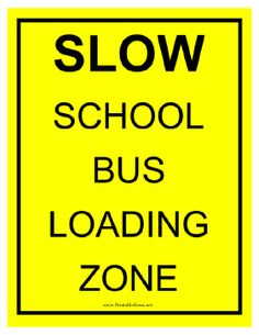 This yellow and black sign indicates that people should slow down for a school bus loading zone. Free to download and print