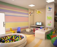 striped wallpaper, tv, entertainment center with storage drawers, table and chairs, rug, planes decor, ball pit, and framed kids-art.