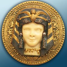 large antique metal and ivoroid button set with cut steels, Egyptian female bust. ca. 1910's