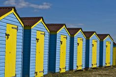 Blue and yellow beach huts - Littlehampton Tours Of England, Online Furniture Stores, United Kingdom, Windows, Doors, Colour, Explore, World, Color