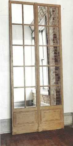 Vintage folding mirror panel!  Great idea! I have a set of doors in storage right now just like these!