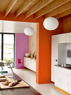 Pink & orange colour blocked kitchen