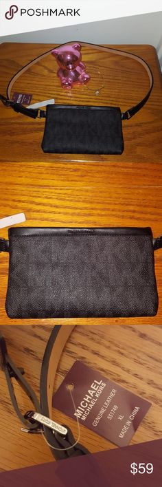NWT Michael Kors Genuine Leather Black Belt NWT Michael Kors genuine leather black belt with attached wristlet. Silver hardware. Three sizes available! Goes great with everything! Top quality designer at a bargain!  Medium, Large, and X-Large Michael Kors Accessories Belts