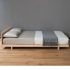 The Kobe is a refined Japanese style low bed, in solid wood. This low bed is available in many solid timbers, including pine and oak. UK Made. Buy online.