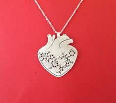 Anatomical heart with oxytocin molecule silver anatomy by Delftia